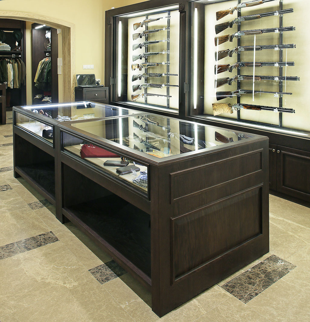 Display cabinets in dark wood for weapons