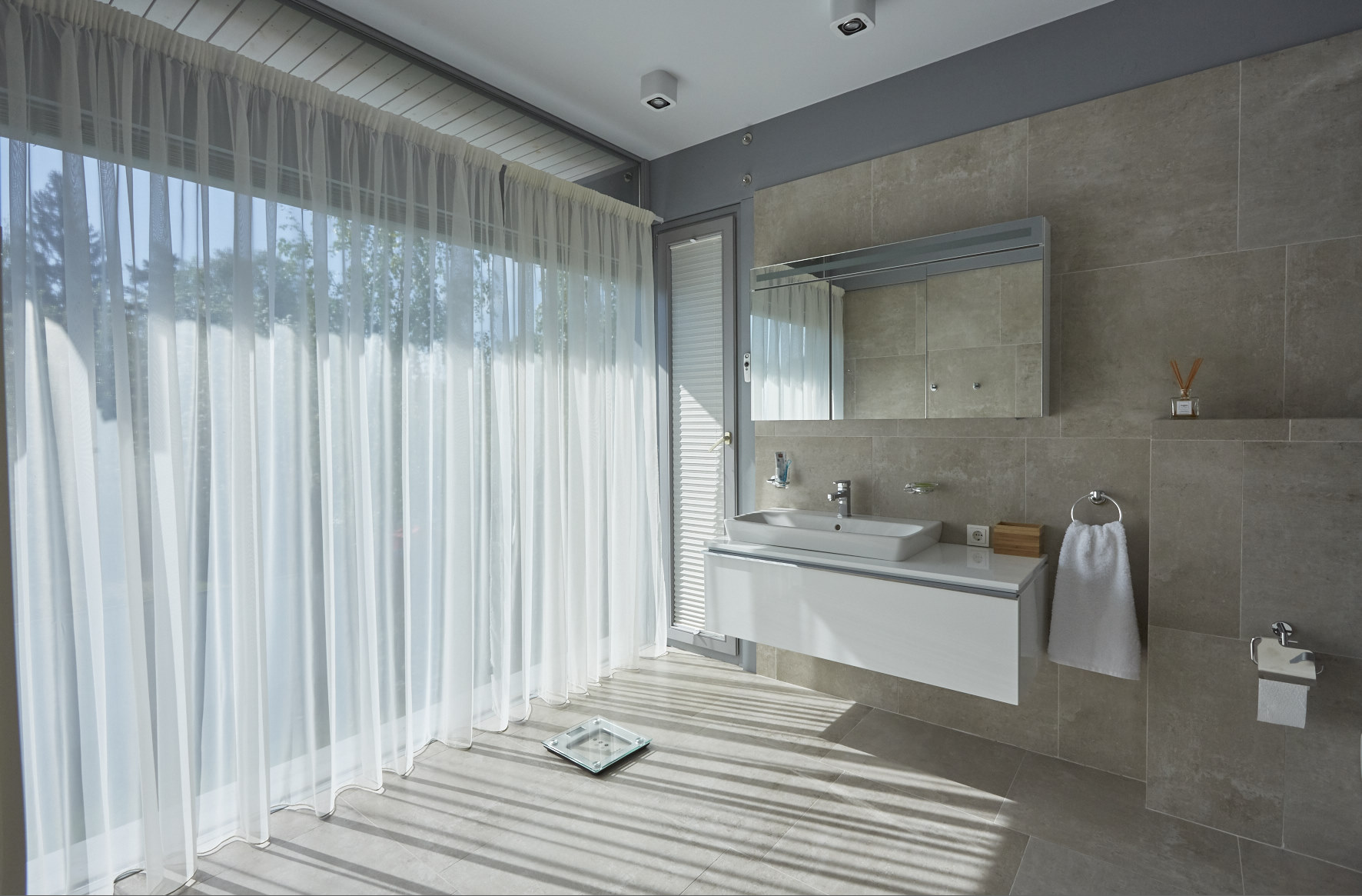 Bathroom with a full height window