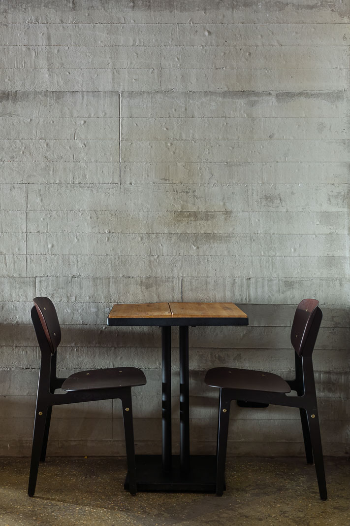 Chairs, table and concrete wall