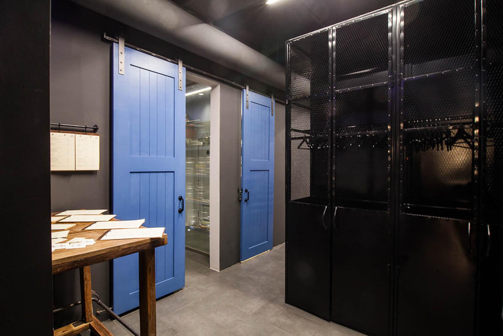 Doors to the barrel room and bathrooms