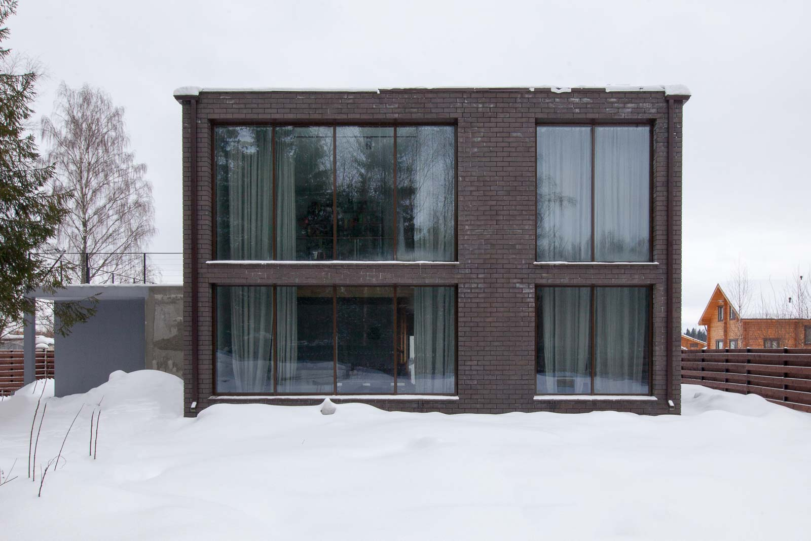 Facade of the house with flat roof in cold climate