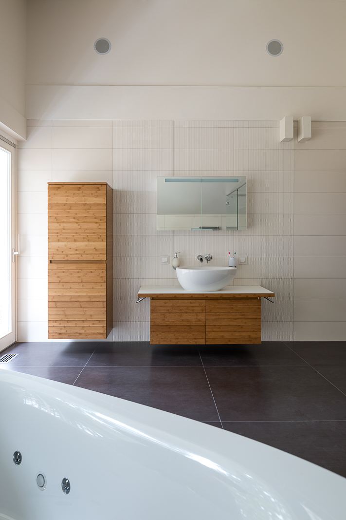 Interior of the bathroom in white with wooden details