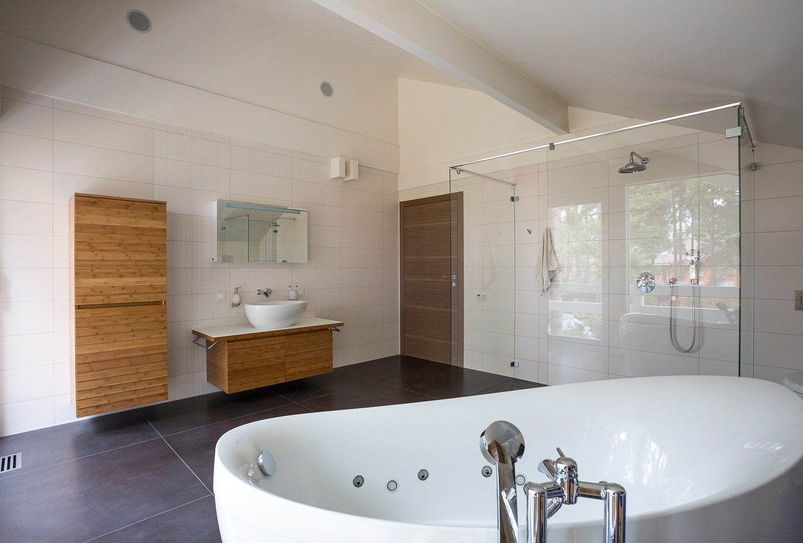 Interior of the master bathroom with wooden details