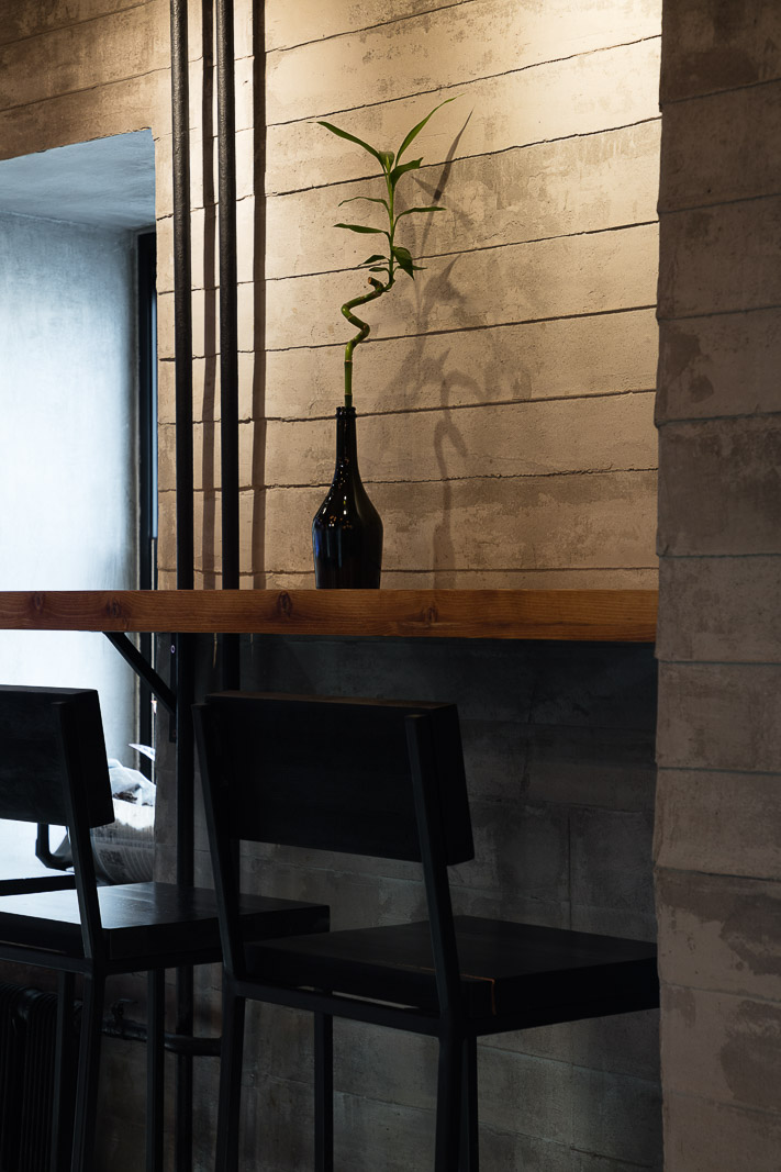 Bar stool and concrete wall