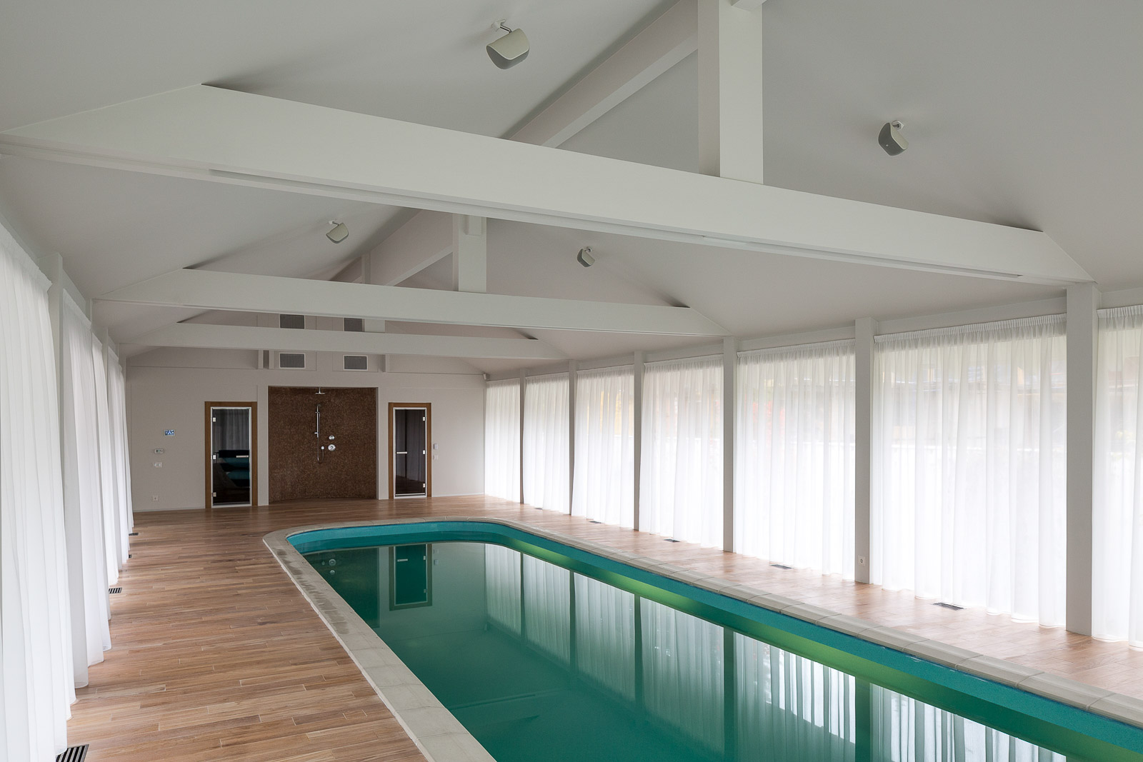 Swimming pool in the contemporary half timbered house