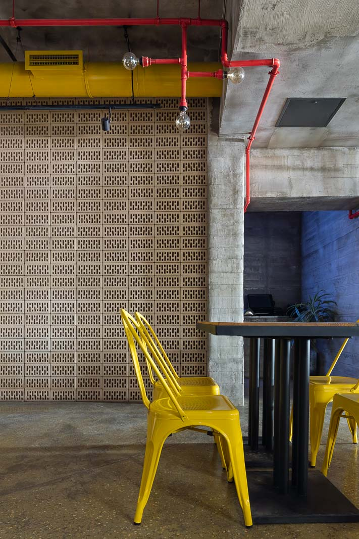 Yellow chairs and brick wall